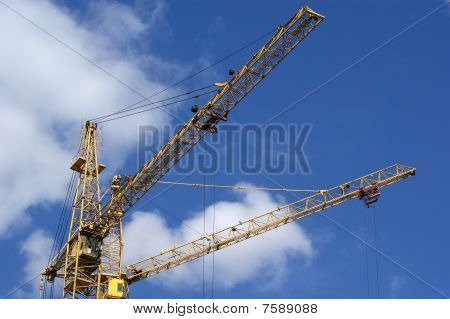 Elevating Construction Crane Against The Blue Sky In A Fair Weather