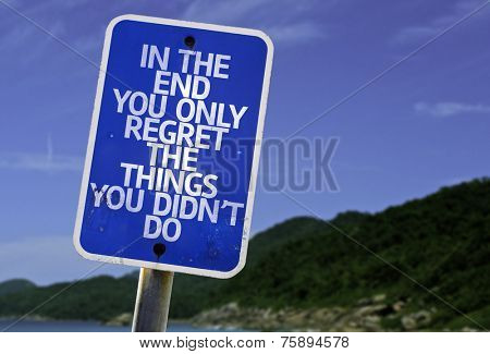 In The End You Only Regret The Things You Didn't Do sign with a beach on background poster