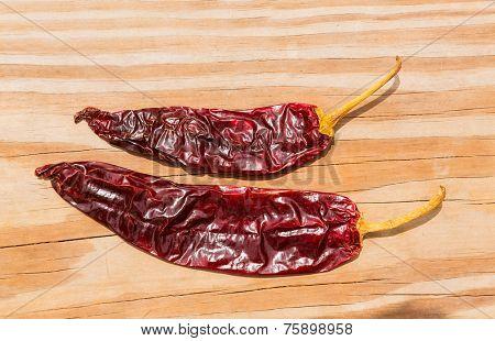 Chile Guajillo seco dried hot chili pepper on wood background