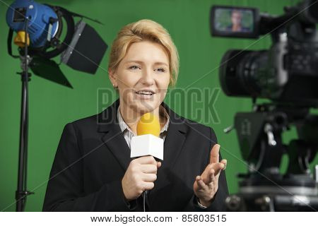Female Journalist Presenting Report In Television Studio