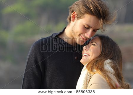 Happy Couple Hugging In Love Outdoors