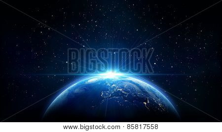 sunrise of earth, blue shining  in the space