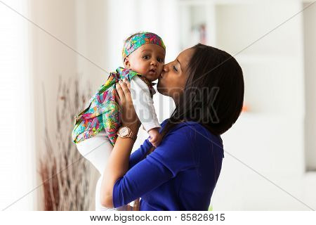 Young African American Mother Playing With Her Baby Girl