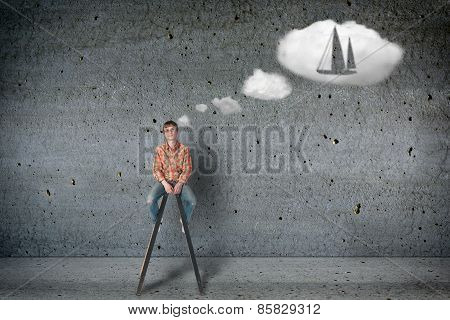 Young man dreams about boat