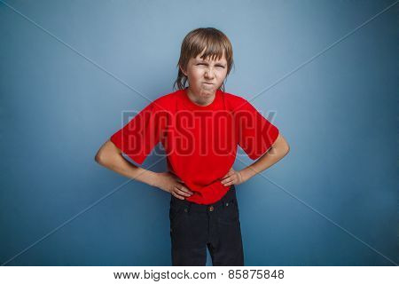 Boy, teenager, twelve years in the red shirt, hands side,