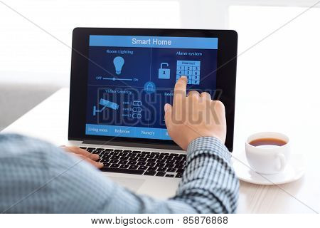 Man Sitting At A Laptop With The Program Smart Home