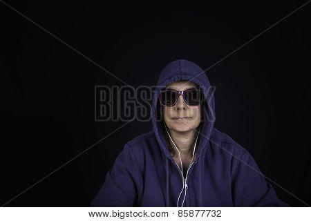 A Portrait Of A Woman Wearing A Hoodie