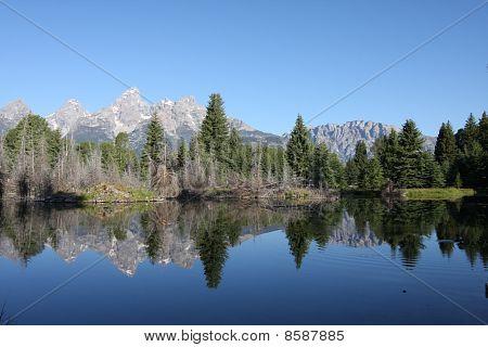 Grand Teton Mountain Range Reflecting In Lake