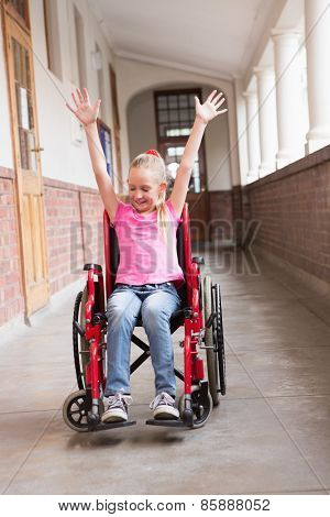 Cute disabled pupil in hall at the elementary school poster