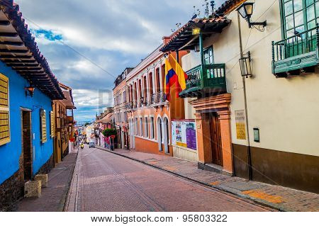 Very charming street in old part of Bogota with small historical townhouses along stone paved narrow