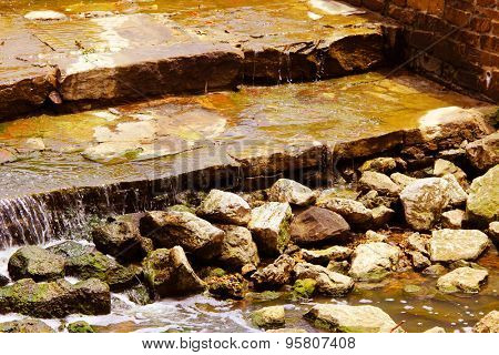 Man-made river with rocky banks in a park