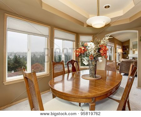 Elegant Dinning Room With Many Windows.