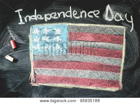 Black chalkboard in classroom with flag of us