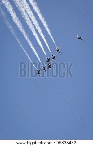 NEW YORK - MAY 22 2015: US Air Force Thunderbird F-16 jets perform the Missing Man Formation aerial salute above Manhattan with precision during Fleet Week NY 2015, part of Memorial Day celebrations.