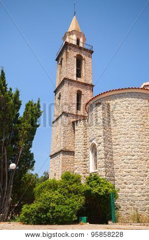 Catholic church exterior bell tower. Sartene South Corsica France poster