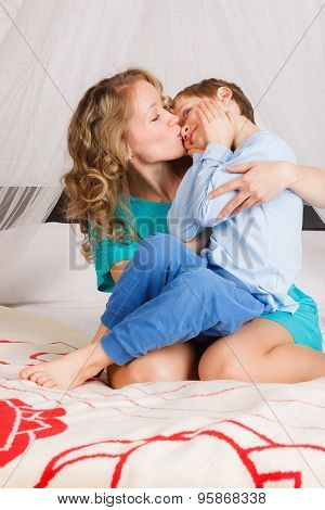 Mother kissing her son to his nose