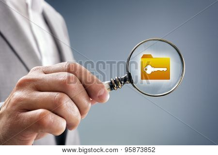 Businessman with magnifying glass over file, folder or document icon concept for security inspection, protection and confidential data