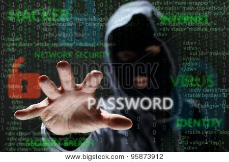 Computer hacker silhouette of hooded man reaching and stealing network password to steal confidential data concept for security, encryption, crime and virus protection