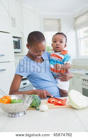 Happy smiling mother with his babyboy in the kitchen