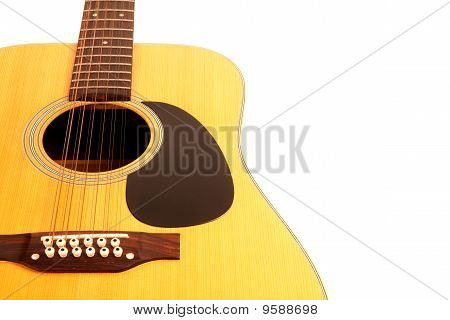 a 12 string acoustic guitar on a white background