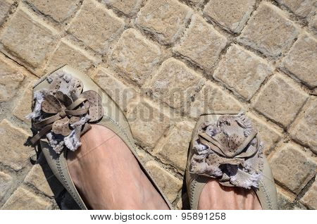 Old Paved Floor Small Beige Stone Tiles With Matching Leather Shoes And Feet Tips