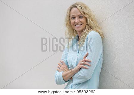 A beautiful blonde model posing outdoors