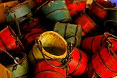 pile of colorful red yellow and green baskets. poster