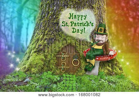 St. Patrick's Day text with Leprechaun sitting on a mushroom in front of a tree with a fairy door, rainbow and fairy sparks of light