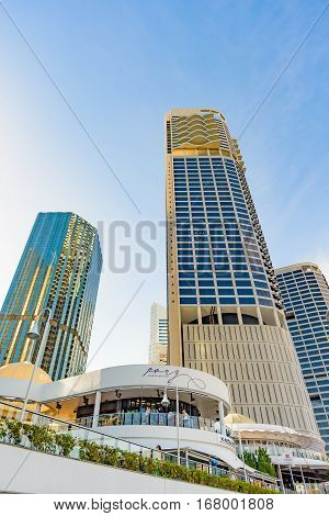 BRISBANE AUSTRALIA - NOVEMBER 19 2016: High rise residential tower blocks and resturants at Riverside and ferry terminal in Brisbane.