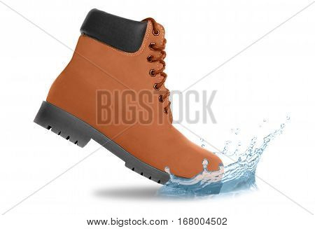 Brown boot and water splash. Side view. Isolated on white background