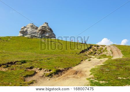 Bucegi Mountains Romania July 09 2015: Unidentified Tourists Visit Bucegi Mountains In Romania On Ju