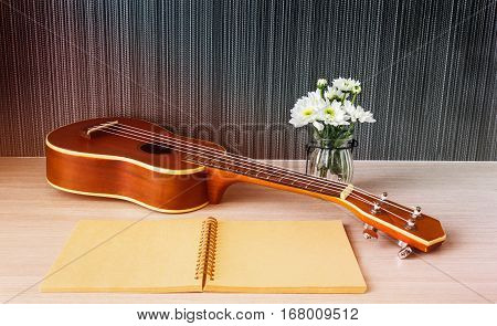 Ukulele And Blank Note Book And Flower For Love Music Concept