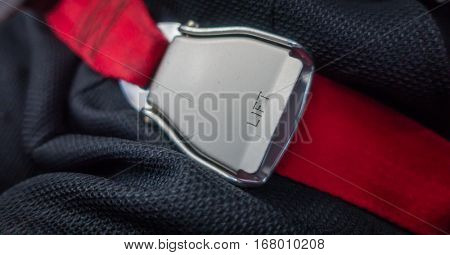 Close up of safety seat belt in the airplane