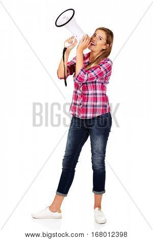 Screaming young woman holding megaphone
