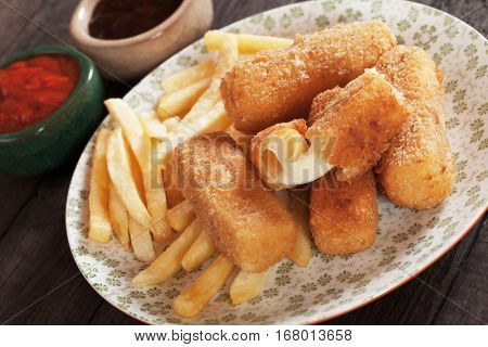 Breaded mozzarella cheese sticks with french fries