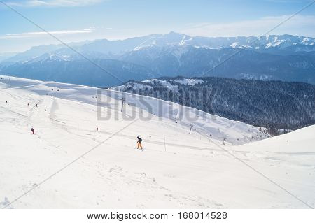 People on a ski slope. The complex mountain-ski runs and facilities in the village of Rosa Khutor.