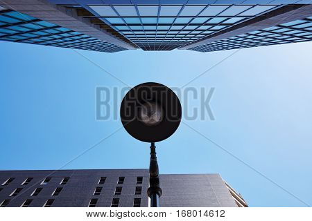 Skyscraper with lamppost and blue sky in an urban city