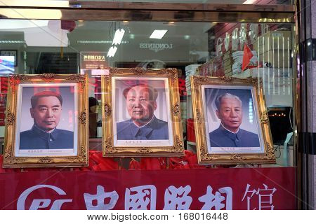 BEIJING - FEBRUARY 23: Portraits of three famous Chinese politicians in shop window on famous Wangfujing Street in central Beijing, China, February 23, 2016.