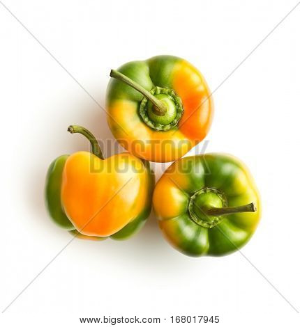 Multicolored bell pepper isolated on white background. Top view.