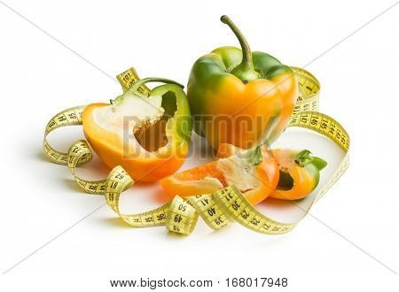 Multicolored bell pepper with measuring tape isolated on white background.