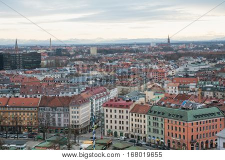 MUNICH GERMANY - JANUARY 09 2011 - Aerial view of Munich and the Alps mountain range in the background