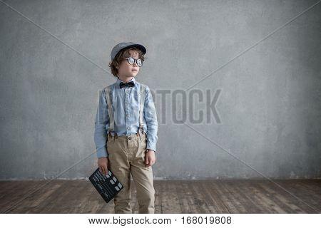 Little boy with clapper in studio