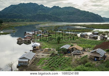 Kanchanaburi Thailand - January112017 : Floating villageTraditional Thai Style House on the raft floating in Kanchanaburi Thailand
