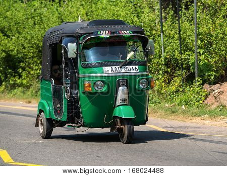 Mirissa, Sri Lanka - January 07, 2017: Tuk-tuk Moto Taxi On The Street. Famous Thai Moto-taxi Called