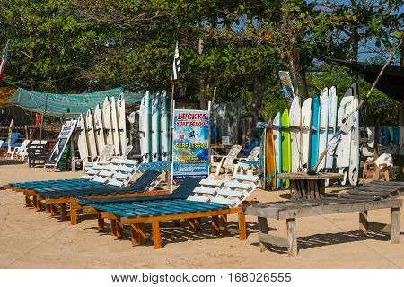 WELIGAMA SRI LANKA - JANUARY 09 2017: Set of different color surf boards in a stack by ocean.WELIGAMA SRI LANKA. Surf boards on sandy Weligama beach. On Weligama beach surf is available all year around for beginner and advanced.