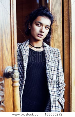 young pretty student teenage indian girl in doors happy smiling, having fun, lifestyle people concept close up