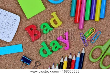 The words Bad day on cork background