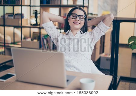 Portrait Of Happy Smiling Businesswoman Having Break And Resting