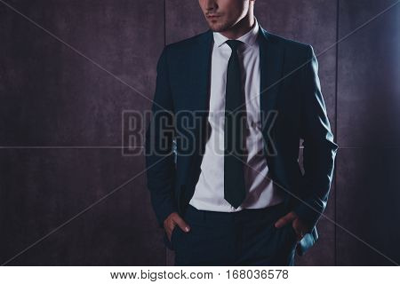 Close Up Of Stylish Young Man In Formalwear Holding Hands In Pockets