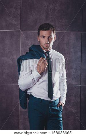 Stylish Handsome Young Man Holding Jaket On Shoulder